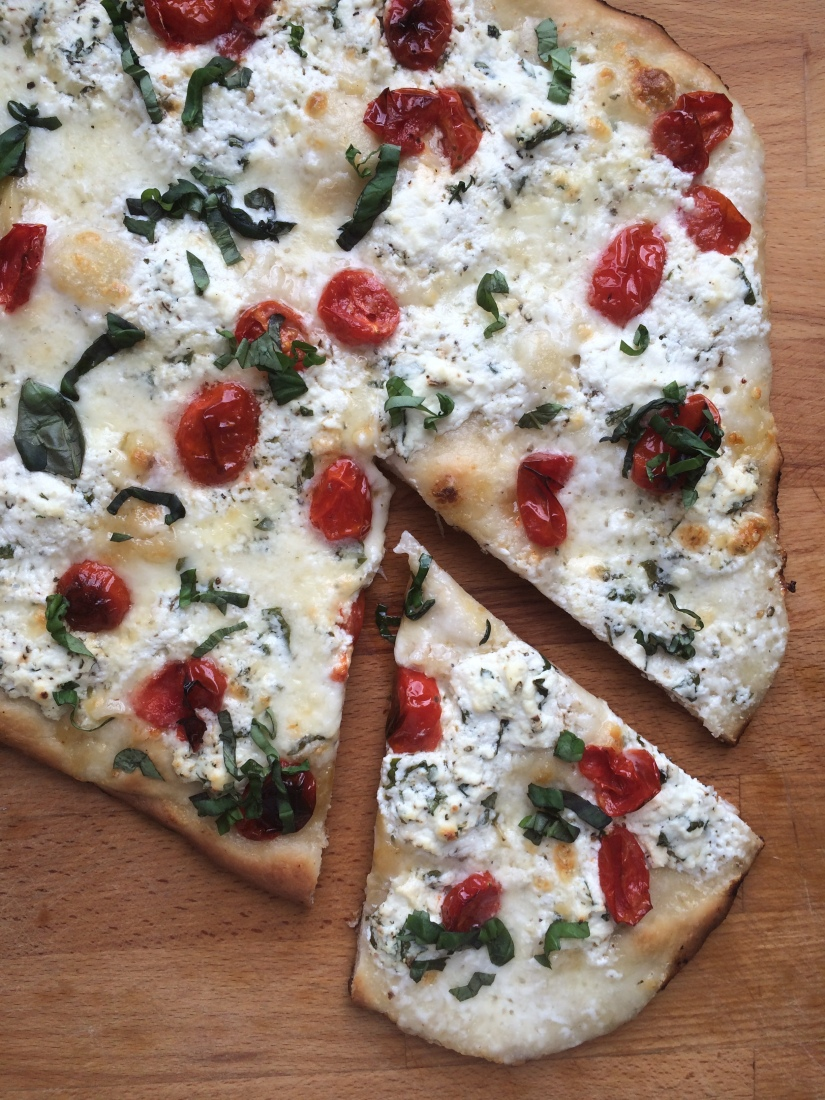 White Pizza with Roasted Garlic, Ricotta, Burrata, and Cherry Tomatoes