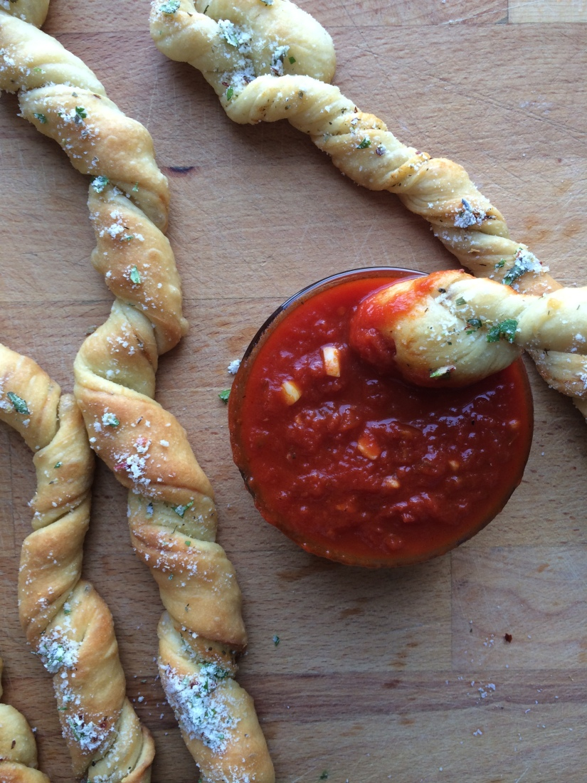 Garlic Herb Bread Twists with Parmesan Cheese and Easy Marinara Dipping Sauce